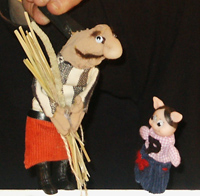 The first little pig met a man carrying a load of straw